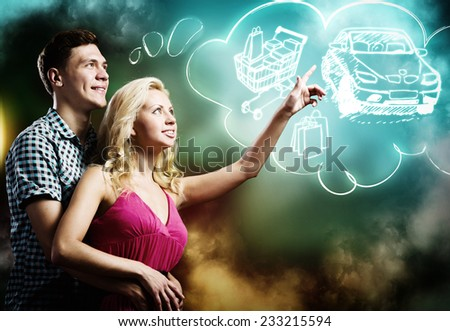 Young happy couple dreaming about family and future life