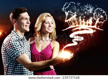 Young happy couple dreaming about family and future life - stock photo