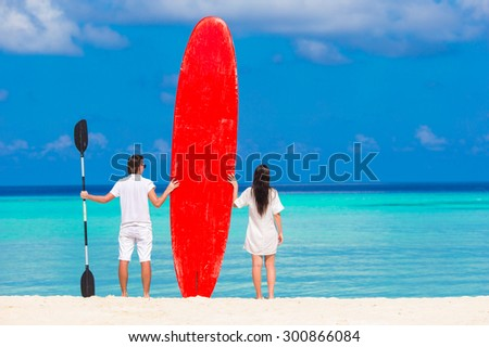 Young happy couple during beach vacation - stock photo