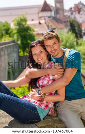 Young happy couple embracing enjoy city view smiling travel vacation - stock photo