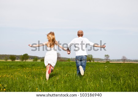 young happy couple have fun in summer outdoor in nature