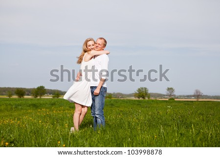 young happy couple have fun in summer outdoor in nature - stock photo