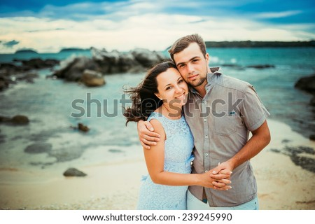 Young happy couple have fun on summer vacation - stock photo