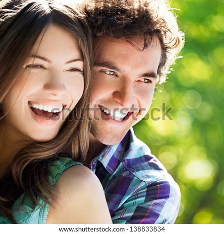 Young happy couple hugging and laughing. - stock photo