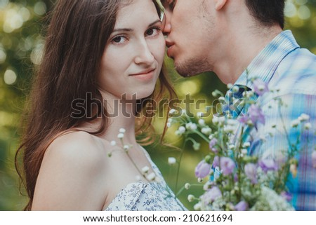 Young happy couple hugging in the park, closeup