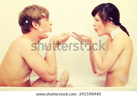 Young happy couple in bath. - stock photo