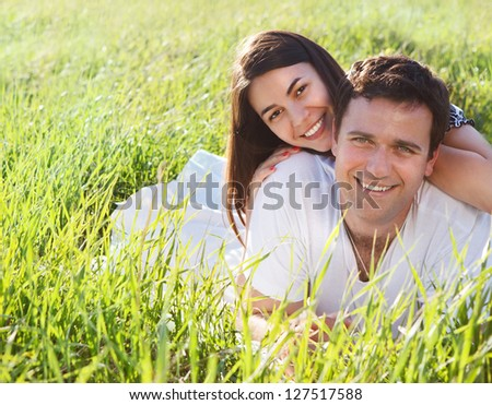Young happy couple in love in spring day. Outdoors portrait - stock photo