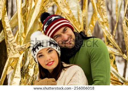 Young happy couple in love outdoors. loving man and woman on a walk in the city - stock photo