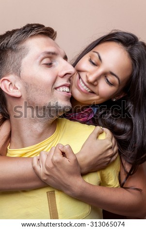 Young happy couple in love smiling - stock photo