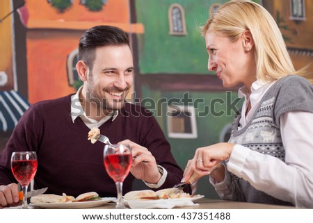 young happy couple in restaurant