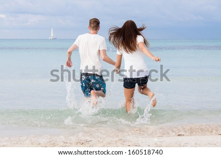 young happy couple in summer holiday vacation summertime beach