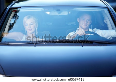 Young happy couple in the car - stock photo