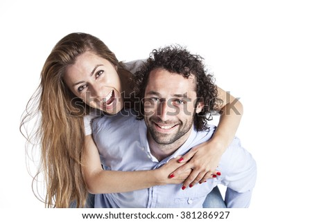 Young happy couple love smiling embracing, man and woman smile looking at camera, isolated on white background