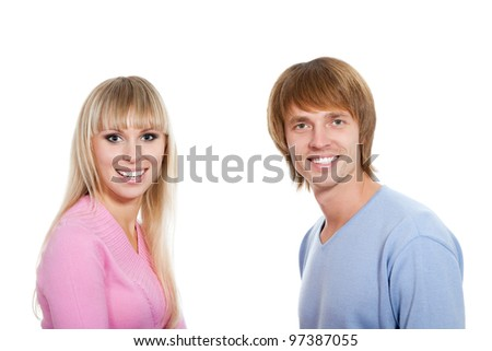 Young happy couple love smiling, wear sweater, looking at camera, isolated over white background - stock photo