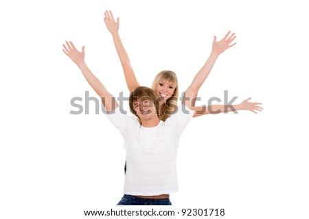Young happy couple love smiling with hands lifted upwards, wear white shirt, looking at camera hold arms and hands up, isolated over white background - stock photo