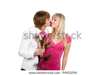 Young happy couple love smiling with pink rose, hug and kissing, isolated over white background - stock photo