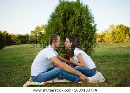 young happy couple on picnic in the park