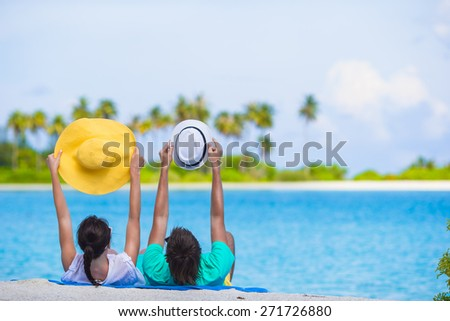 Young happy couple on white beach at summer vacation - stock photo