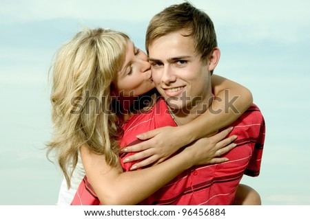 young happy couple outdoors - stock photo