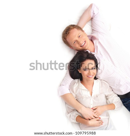 Young happy couple over white background - stock photo