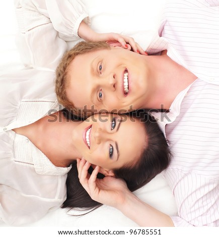 Young happy couple over white background