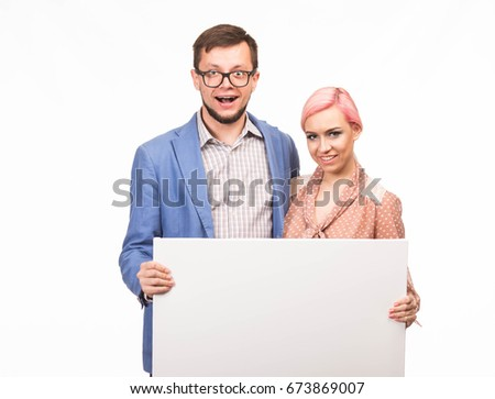 Young happy couple portrait of a confident businessman showing presentation, pointing paper placard background. Ideal for banners, registration forms, presentation, landings, presenting concept.