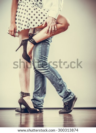 Young happy couple retro style dancing studio shot on gray - stock photo