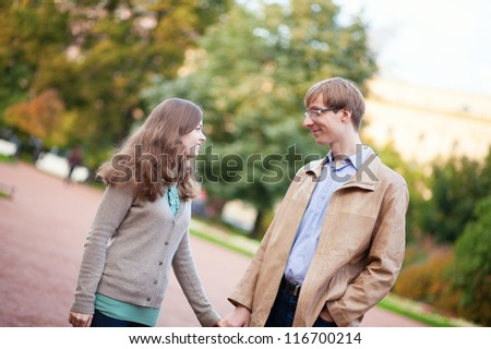 Young happy couple spending time together outdoors - stock photo