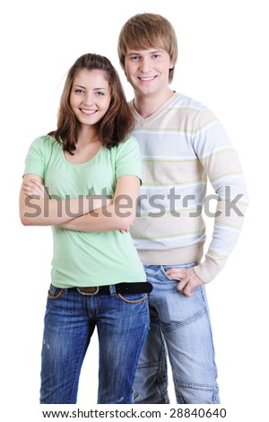 young happy  couple standing together - isolated on white background