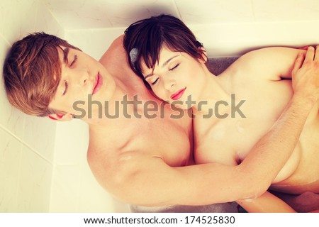 Young happy couple taking a bath.