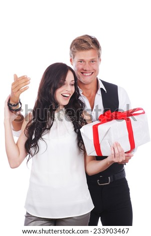 Young happy couple with  gifts