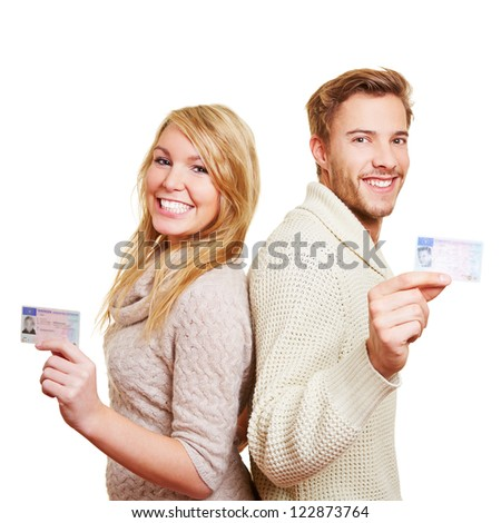 Young happy couple with their new European driving licence - stock photo