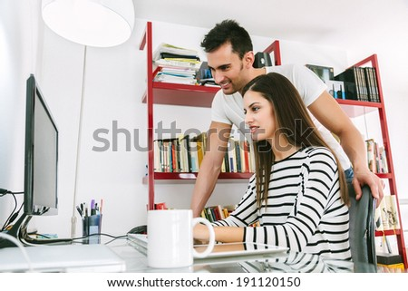 Young Happy Couple Working at Home - stock photo