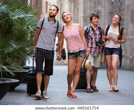 Young happy couples  during city walking - stock photo