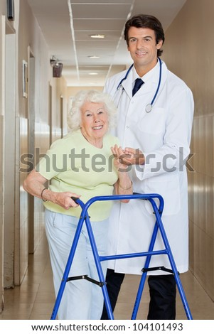 Young happy doctor helping a senior woman with her walker