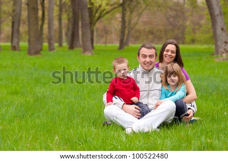 Young happy family having fun in the nature on beautiful spring day.