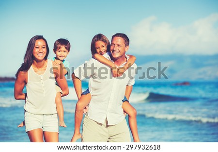 Young Happy Family Having Fun on the Beach Outdoors - stock photo