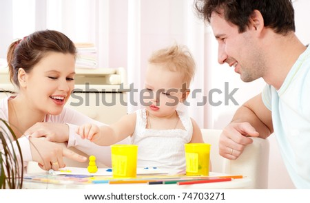 Young, happy family in a room interior