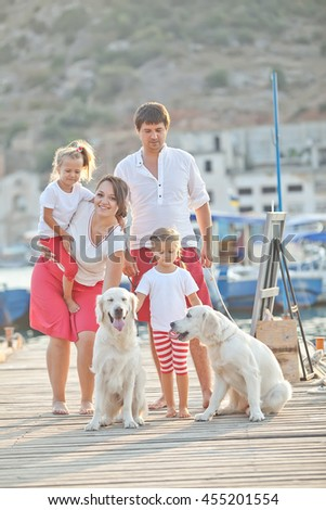 Young happy family of four people with pets