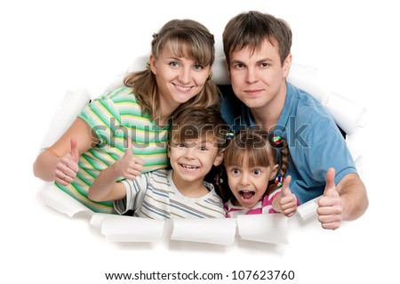 Young happy family playing together through a hole in paper isolated on white background