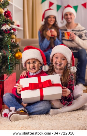 Young happy family while celebrating Christmas at home