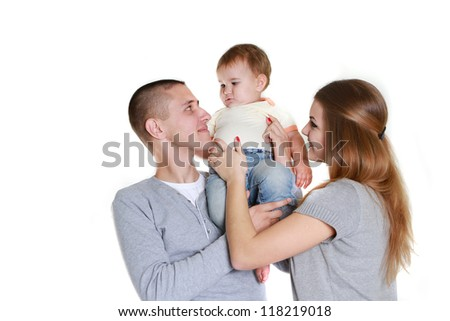 young happy family with child, studio portrait, isolated over white - stock photo