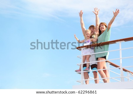 young happy family with little girl with hands up, rests on yacht and is glad at life from soul - stock photo