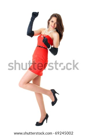 young happy female in red strapless dress, studio shoot isolated on white - stock photo