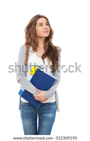 Young happy female student looking looking up isolated on white. - stock photo
