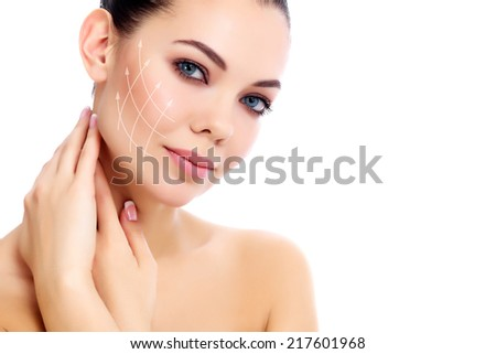 Young happy female with clean fresh skin, white background   - stock photo