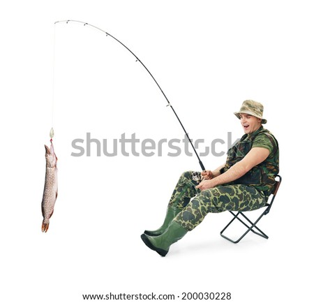 Young happy fisherman in camouflage catching a fish sitting on a chair isolated on white background - stock photo