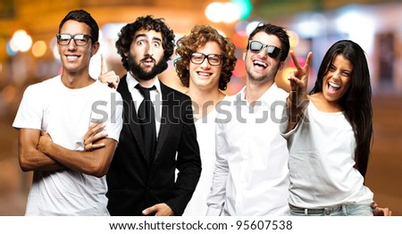 young happy friends at city by night - stock photo