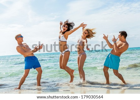 young happy friends havin fun on the beach summer holiday - stock photo
