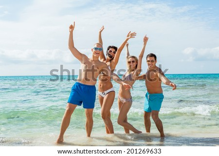 young happy friends havin fun on the beach summer holiday